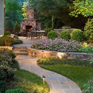 backyard landscape ideas photo of a large traditional backyard stone landscaping in dc metro with PBDGGMD
