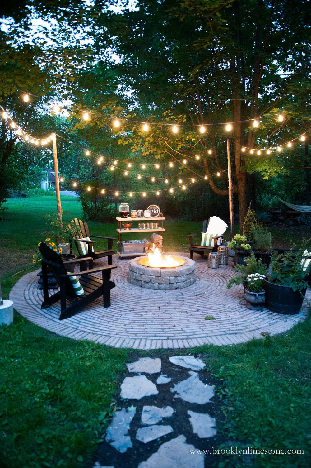backyard lighting ideas cozy outdoor fire pit and string lights VNYMERP