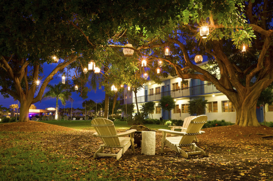 backyard lighting ideas one creative idea is to hang various contrasting lanterns from trees. in MPTEPRW