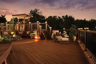backyard lights trex backyard lighting warmly illuminates a composite deck at night OHVAYGQ