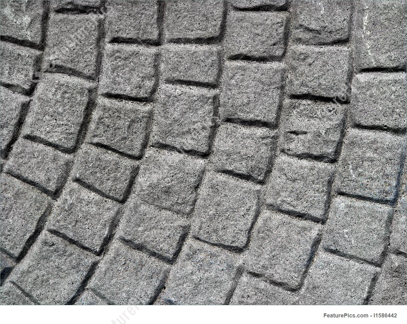 close view of an abstract image made with paving stones. SYHOXDQ