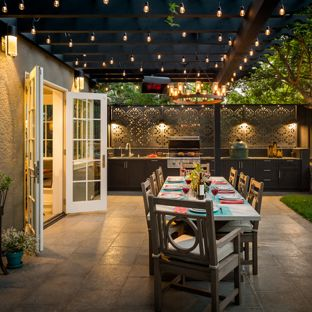 covered patio ideas example of a classic backyard patio kitchen design in san francisco with YQJMVIC