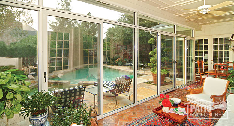 enclosed patio overlooking pool (interior). CAQTMPH