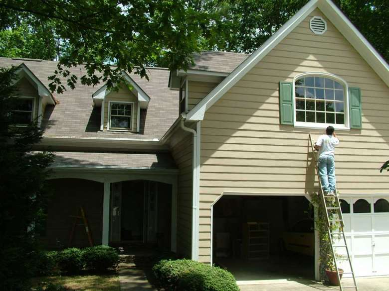 exterior house painting how often does an exterior of a house need painting in the ESQLFWY