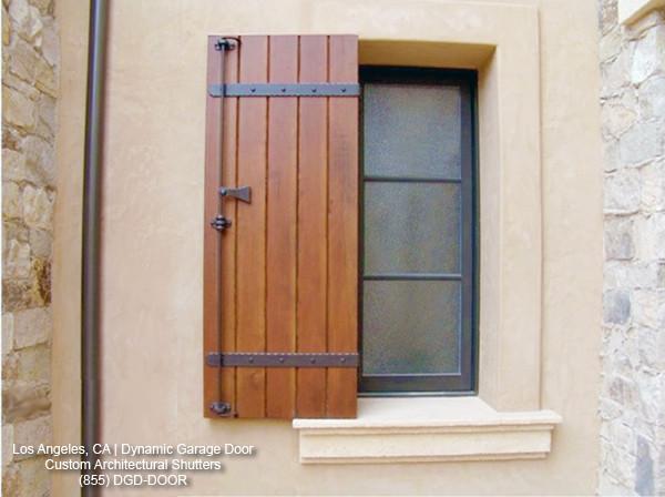 exterior wood shutters custom wood shutters in a tuscan style design mediterranean-exterior TSWBCQQ