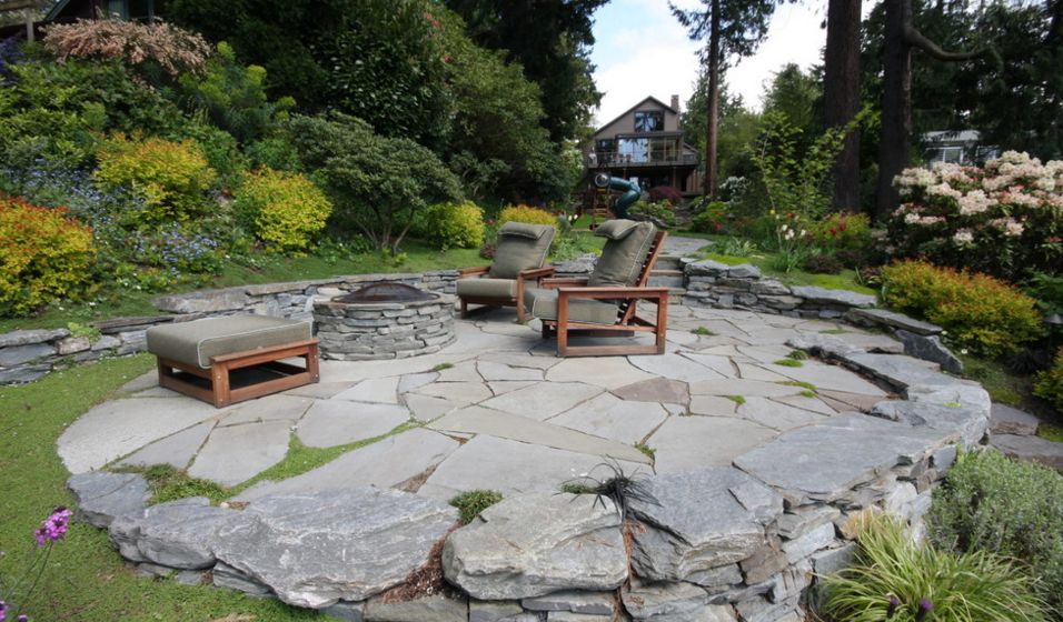 flagstone patio ... this is a contemporary patio featuring organic lines and materials LAIIRSC