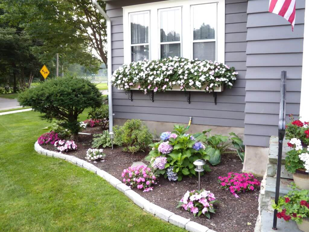 front yard landscaping ideas 1. cheerful floral border and window boxes KSYCOZS