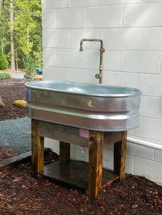 garden sink stock tank sink. pallet wood base. FMTVGRC
