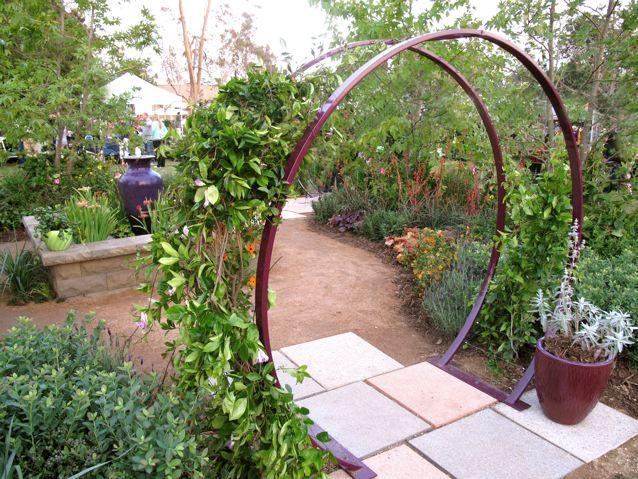 garden trellises above: the gracie modern arbor in aubergine. each sculpture is painted in ZPHOPJV