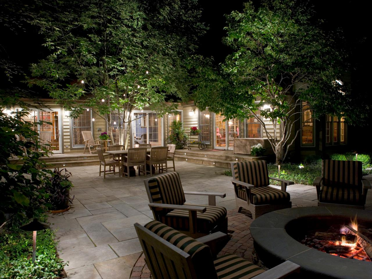 outdoor landscape lighting how to illuminate your yard with landscape lighting NWTIVKM