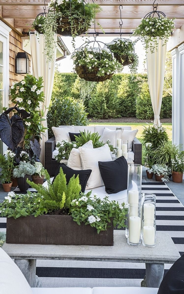 patio decor 25. plant lovers paradise with armchair and table HIATRCO