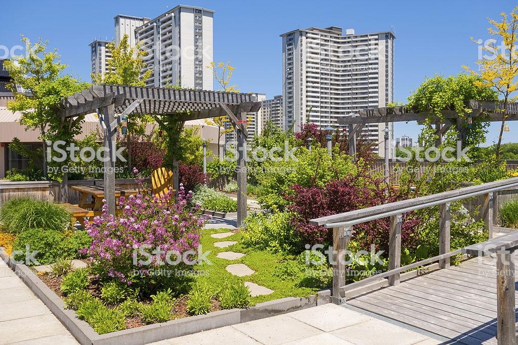 roof garden on top of apartment building stock photo XFHETNB