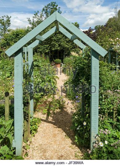 wooden garden arches green painted wooden arch arbour over garden path, barnsdale gardens,  oakham, AMKLXSX