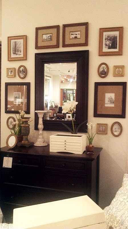 Ground a wall gallery with a centerpiece, such as a large wall